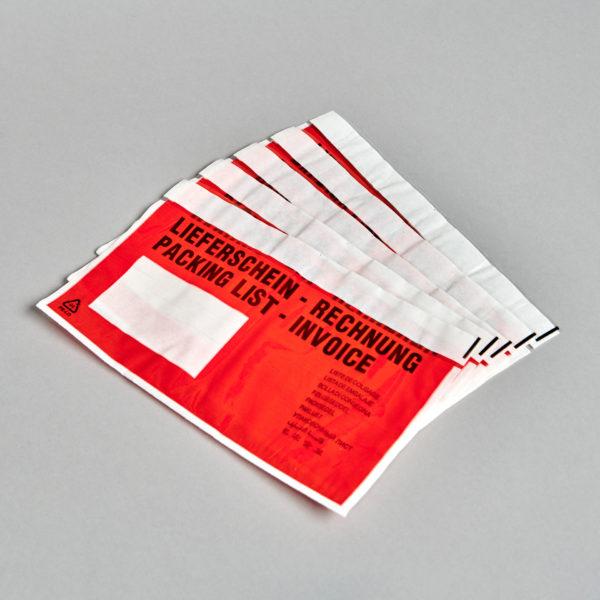 Lieferschein-Klebetaschen, rot, liegend aufgefächert